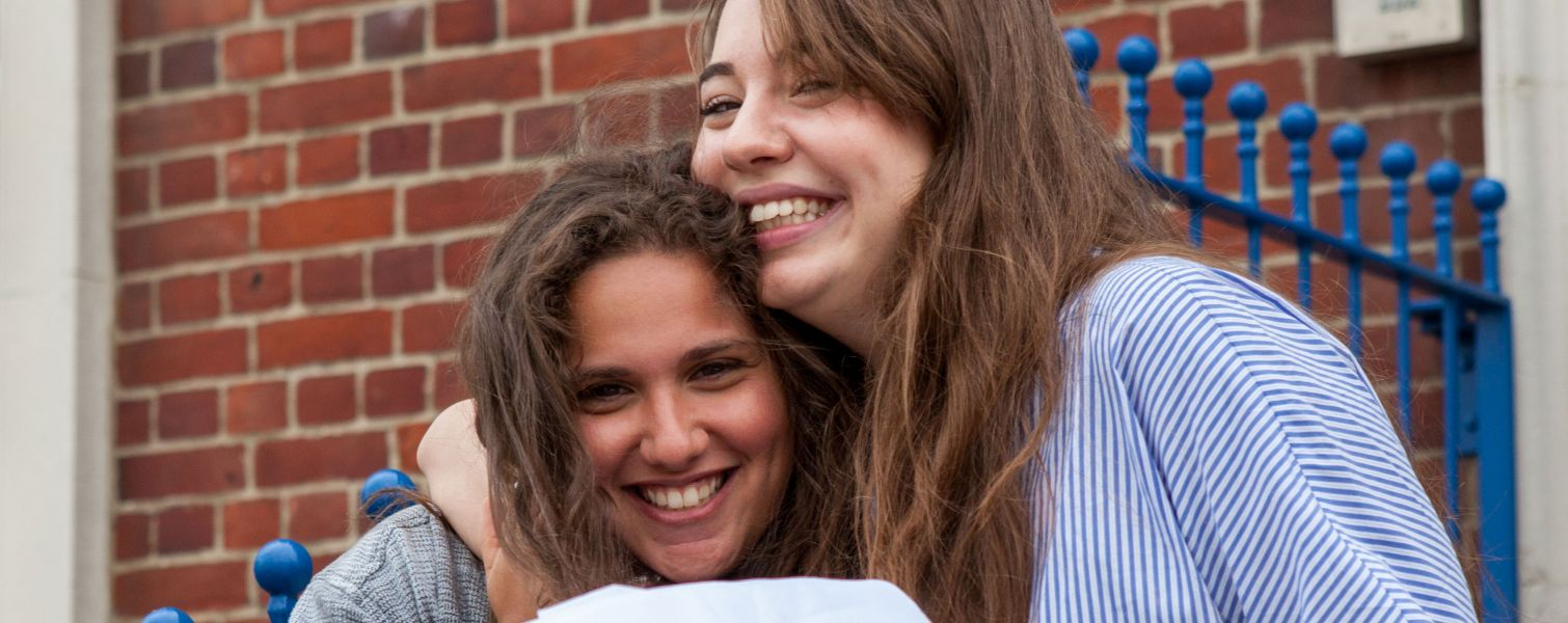 two happy teenage girls on results day