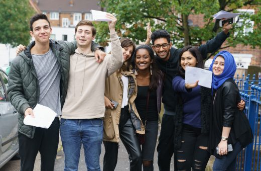 Students all grouped together celebrating their amazing results