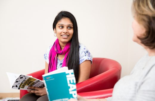 """A student reading through a """"graduate jobs"""" booklet"""
