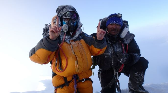 two people in snow gear