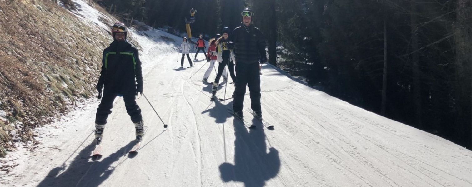 Students going down a ski slope together