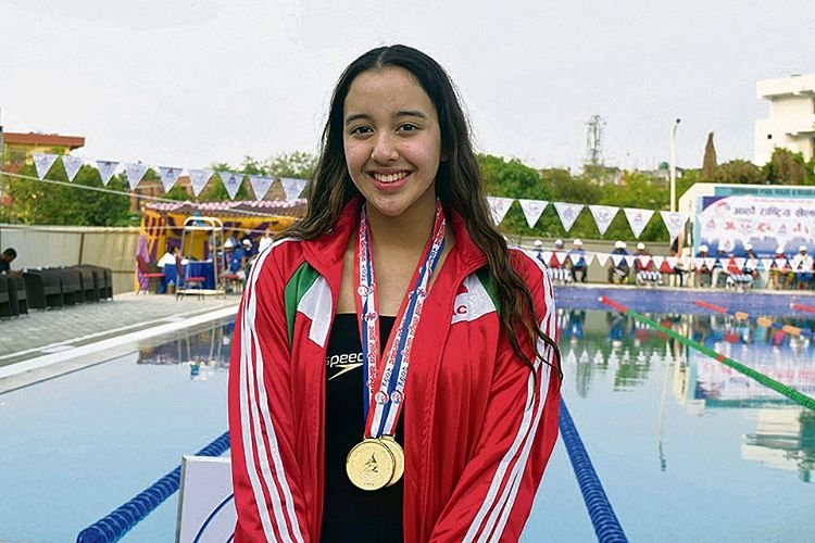girl with swimming medal